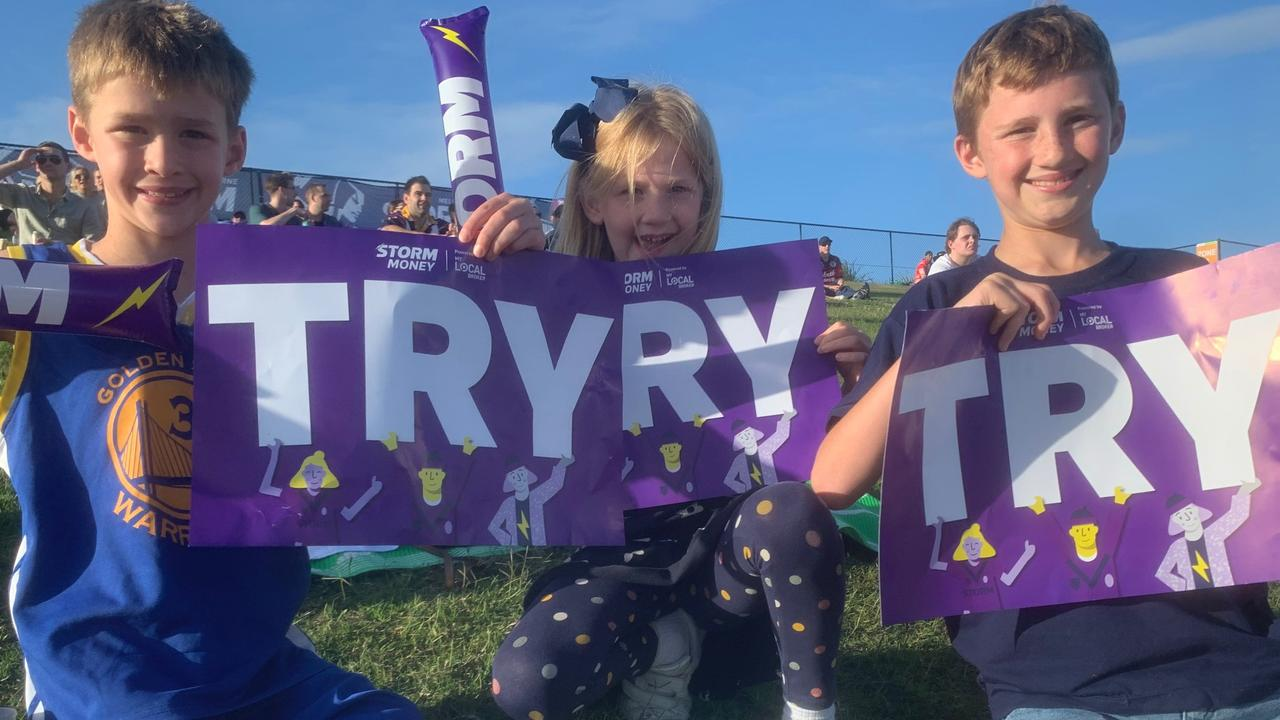 Ben, Holly, and Nicholas Barradeen celebrate another Melbourne Storm try at Sunshine Coast Stadium.