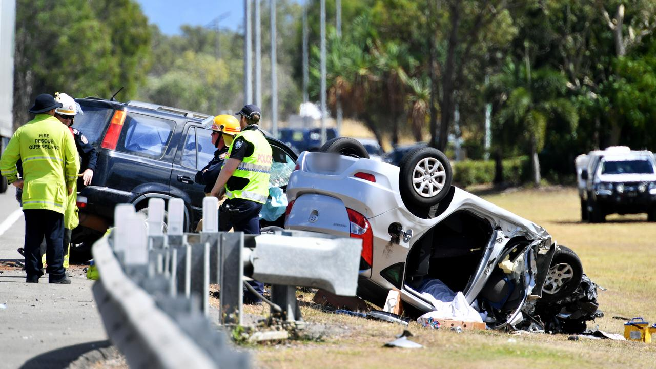 Emergency services attend a fatal crash involving three vehicles just north of the Yabulu Overpass. Picture: Alix Sweeney