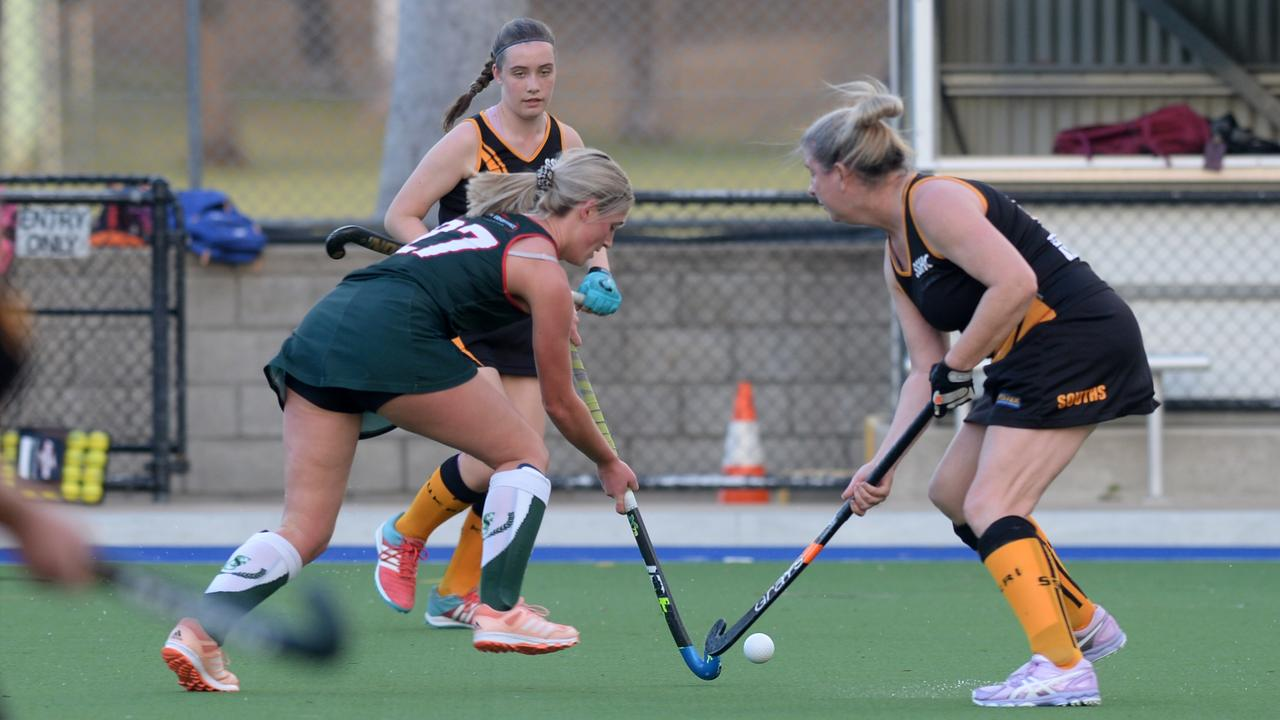 Frenchville Rovers' Amy Mills and Southern Suburbs Black's Christine Woods in the Division 1 women's semi-final on Saturday. Photo: Jann Houley