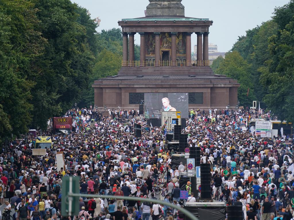 Tens of thousands of people including coronavirus sceptics, conspiracy enthusiasts, hippies, right-wing extremists, religious conservatives and others converged on Berlin to attend the protests. Picture: Getty Images