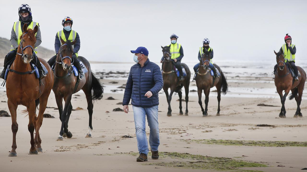Champion trainer Danny O'Brien on 13th Beach Barwon Heads early morning training. Danny with 2019 Melbourne Cup winner Vow and Declare (left) on the beach during a workout. Picture: David Caird