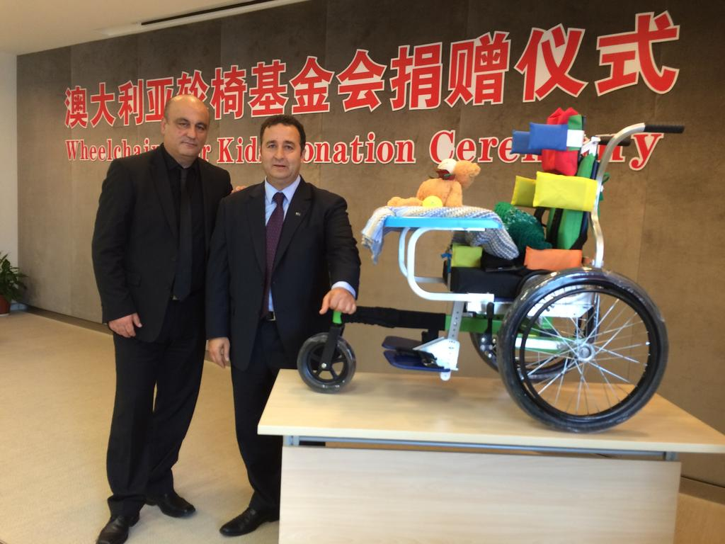 Mr Moselmane (right) with human rights activist Gerry Georgatos (left) on a trip to China raising money to facilitate wheelchairs being sent to disabled children. Picture supplied.