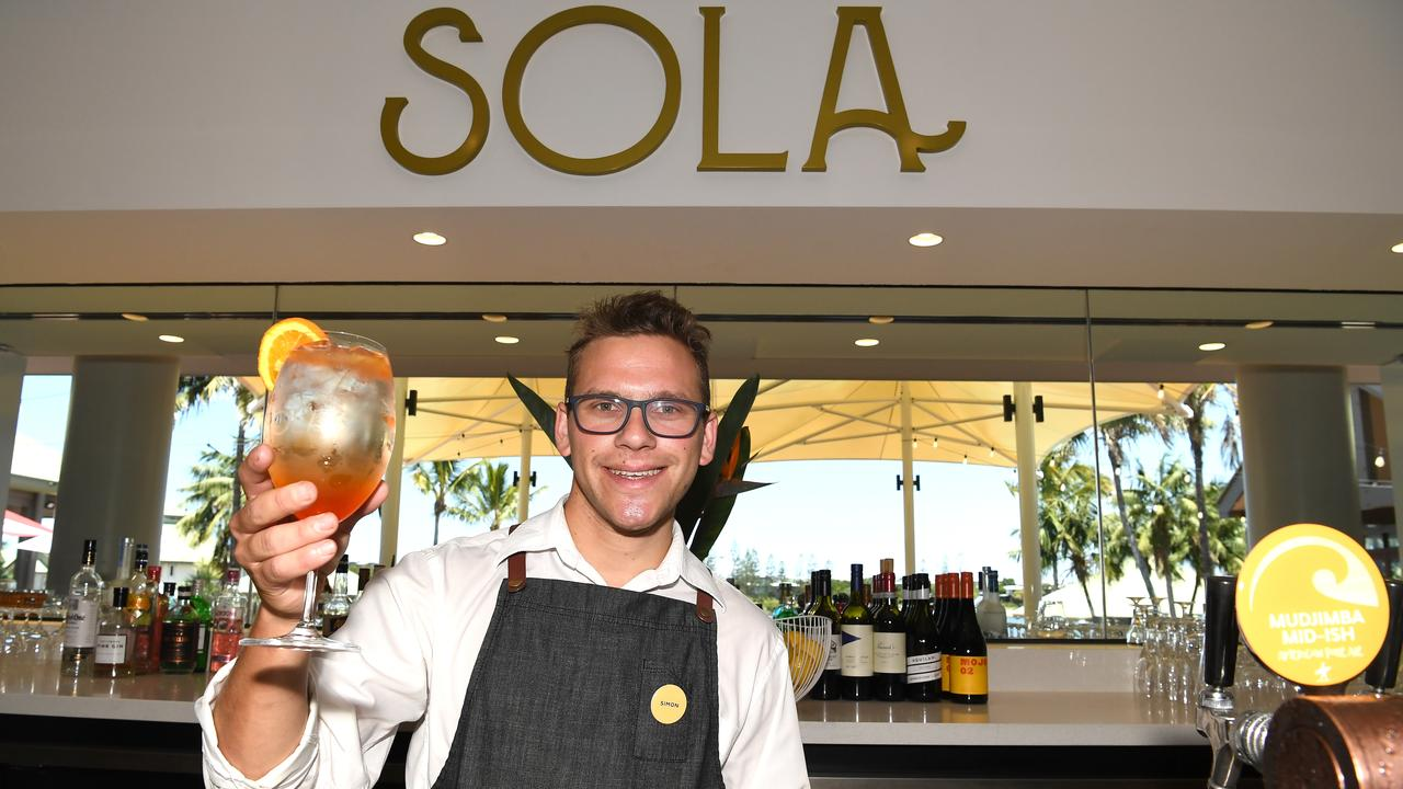 Simon Weybury serves up a drink at the bar at Novotel Sunshine Coast Resort when it was opened in September 2019. Picture: Warren Lynam