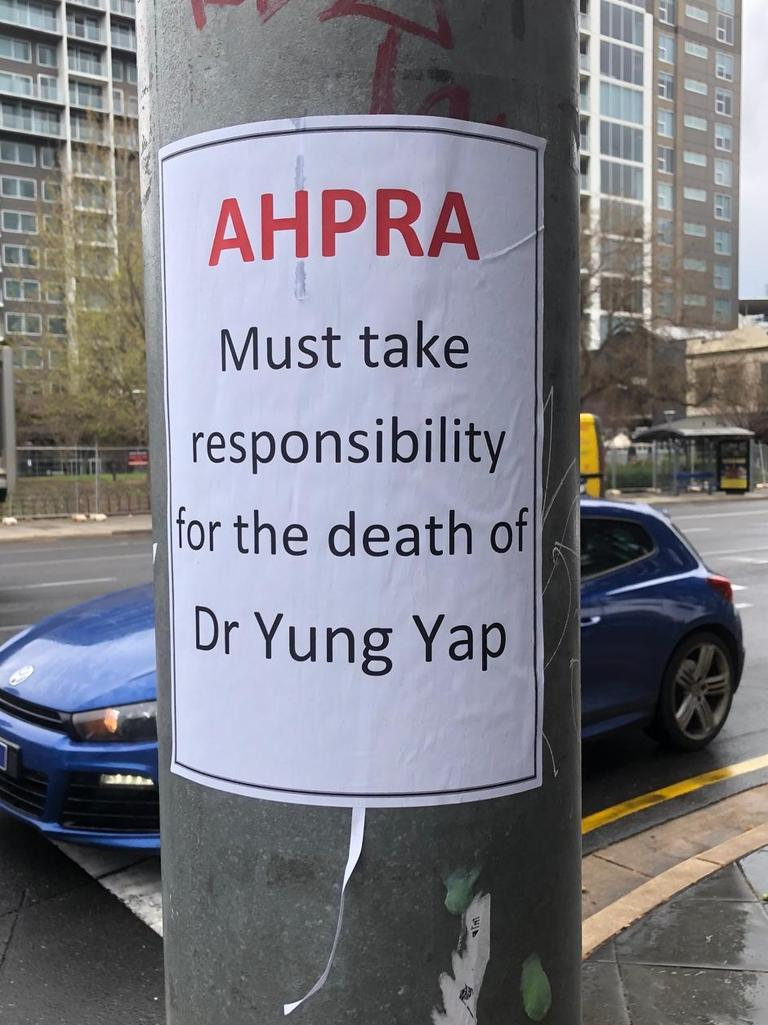 Posters have been placed in the city blaming AHPRA for Dr Yap's death.