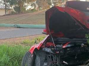 PHOTOS: Car mangled after crashing into pole near Gympie
