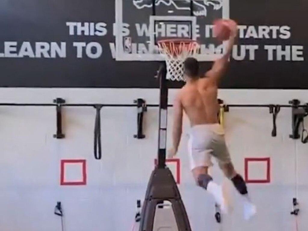 A talented baskballer during his school days, Crichton lays down a big windmill dunk.