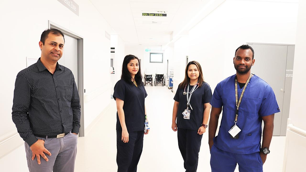 Gladstone Hospital Director of Medical Services Dr Dilip Kumar congratulates Dr Phyoe Pa Pa Aung, Dr Rachna Pagnis and Dr Alwin Selvaraj on being accepted into the ACEM training program.
