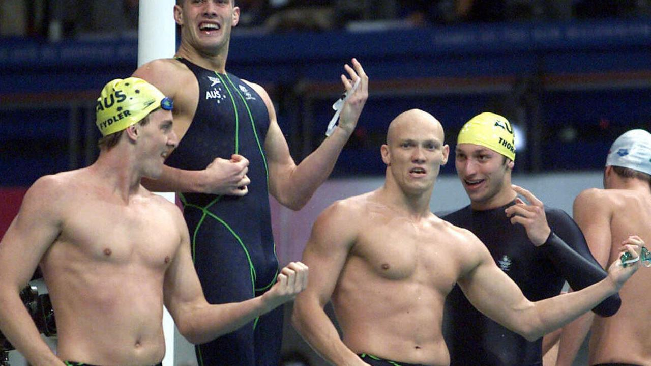 The 'smash 'em like guitars' race is now part of Australian sporting folklore but here's the story of the terrifying anxiety the four swimmers went through.
