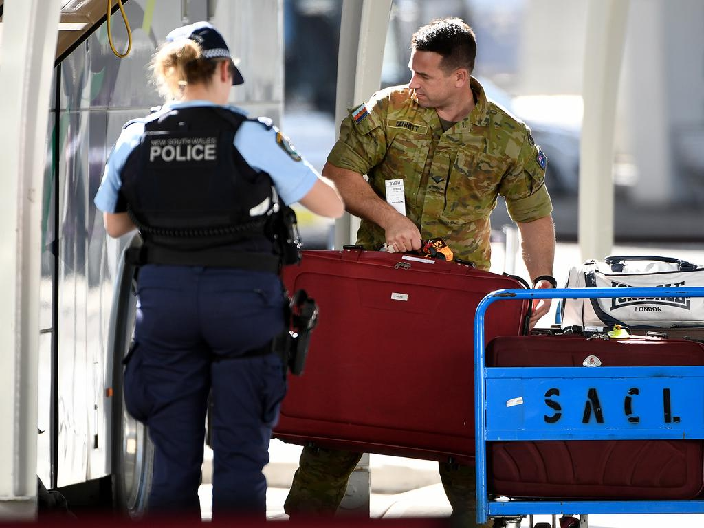 Australian Defence Force personnel have been tasked with helping Australian residents returning from overseas move to 14-day hotel quarantine. Picture: AAP Image/Bianca De Marchi