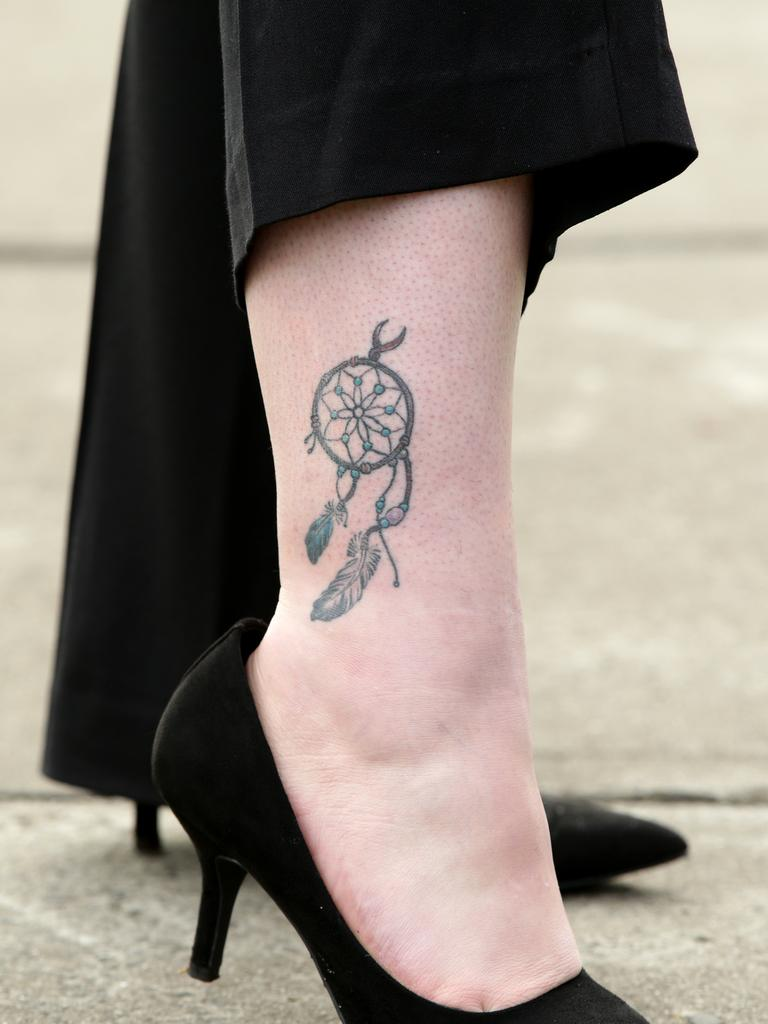 The dreamcatcher tattoo on Casey's calf. Picture: Jonathan Ng.