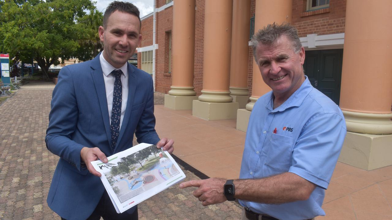 Councillor Daniel Sanderson and PBS company director Wayne Ahrens with plans of the new water park to be built in Maryborough. Photo: Stuart Fast