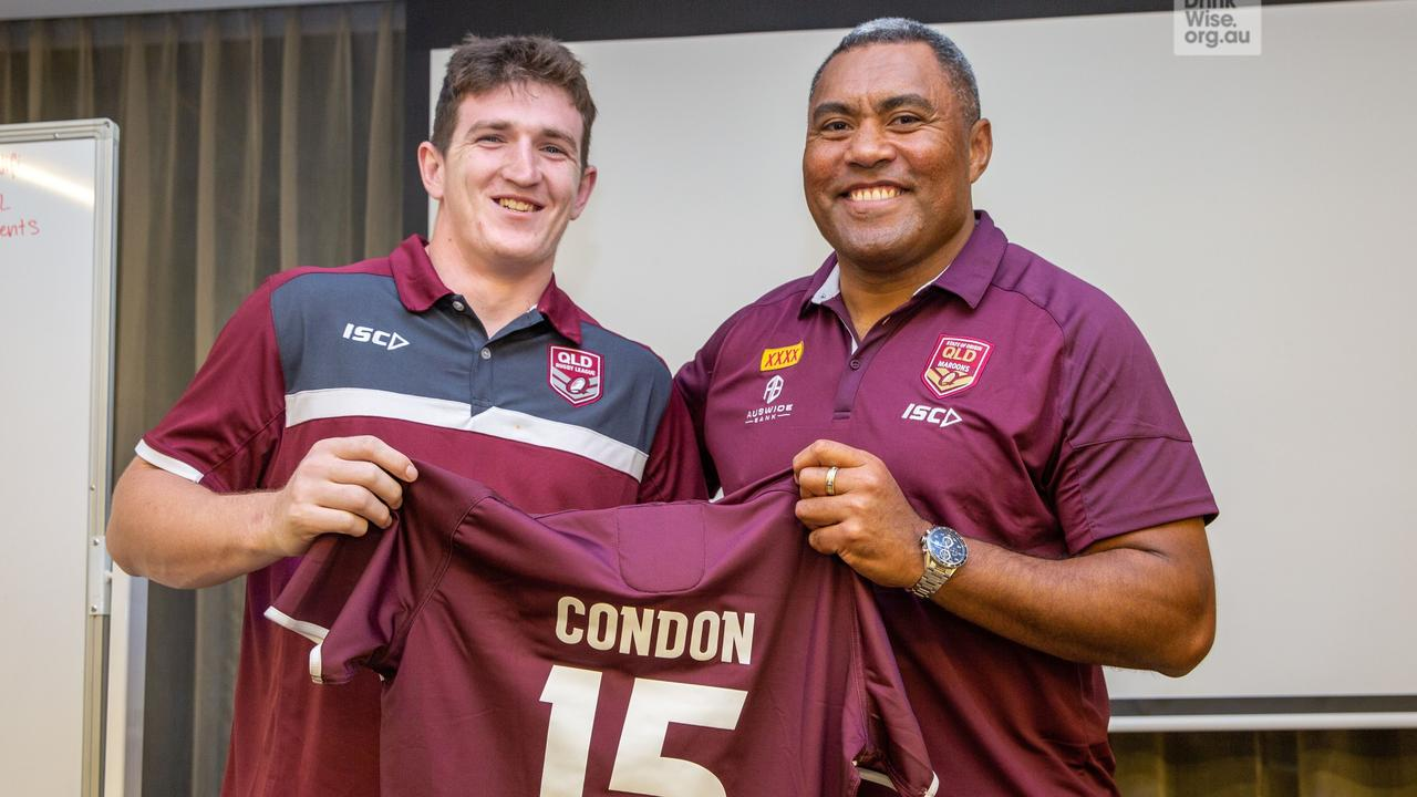 Ben Condon receiving his Queensland under-20 jersey from league legend Petero Civoniceva.