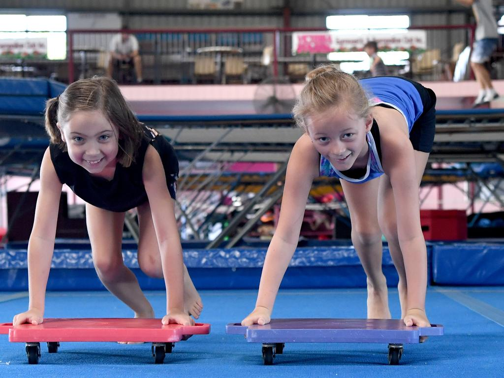 Maggie Mueller and Jenna Richards enjoy some holiday fun at the Victoria Park Gymnastics and Trampoline club.