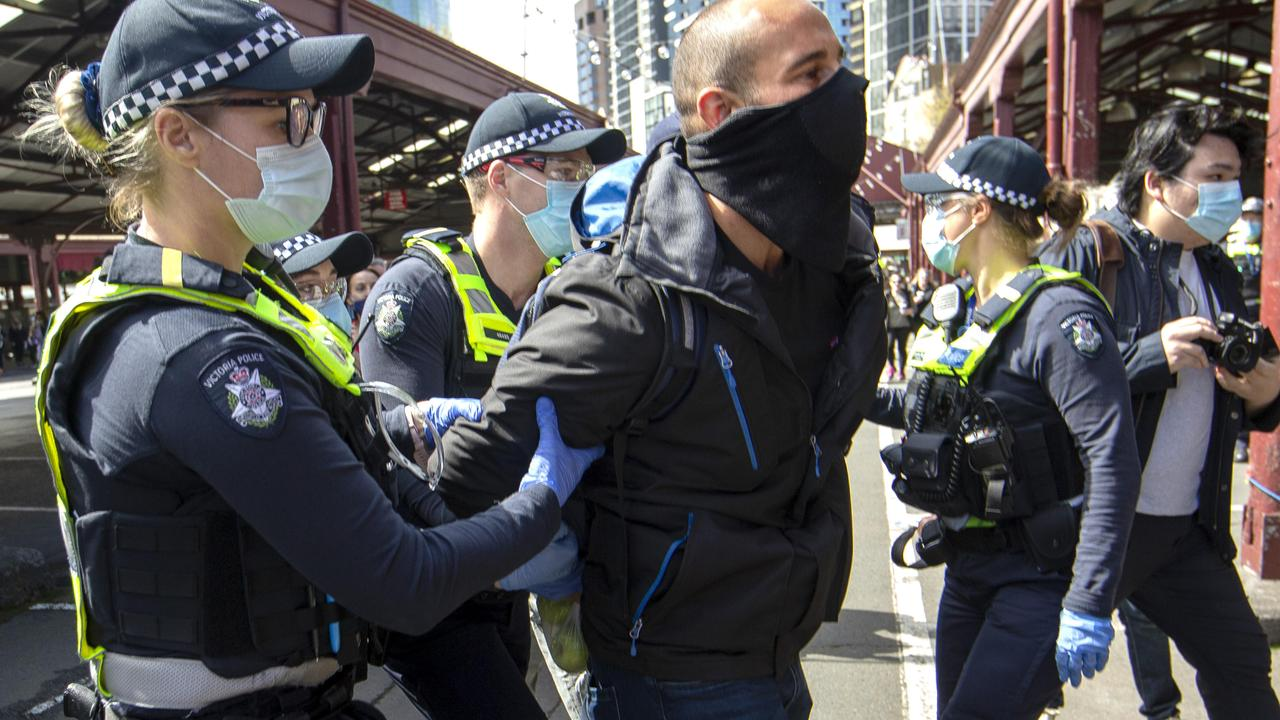 Police arrest a protester at a Melbourne Freedom Walk at Queen Victoria Market on Sunday. Picture: NCA NewsWire / David Geraghty
