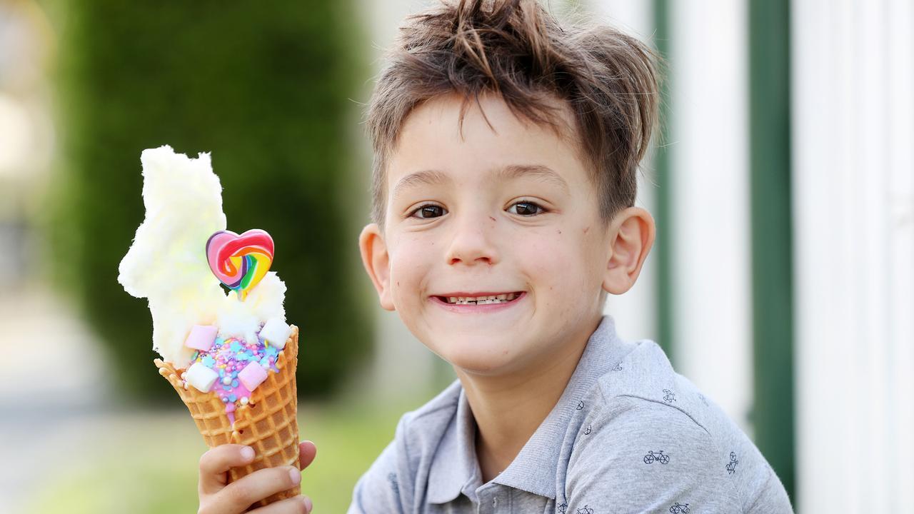 YUM: 6-year-old Tommaso Casa enjoys the limited edition Troll-themed ice cream from Baskin-Robbins for the #TrollForGood initiative. Pics Tara Croser.