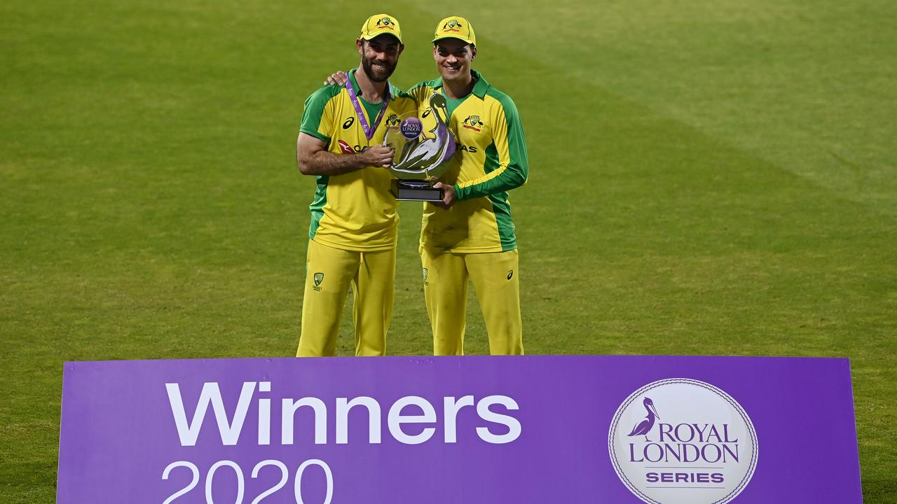 Aussie batsmen Glenn Maxwell and Alex Carey pose with the Royal London One Day Series trophy after Australia's stunning victory in the third ODI in Manchester. Picture: Shaun Botterill/Getty Images