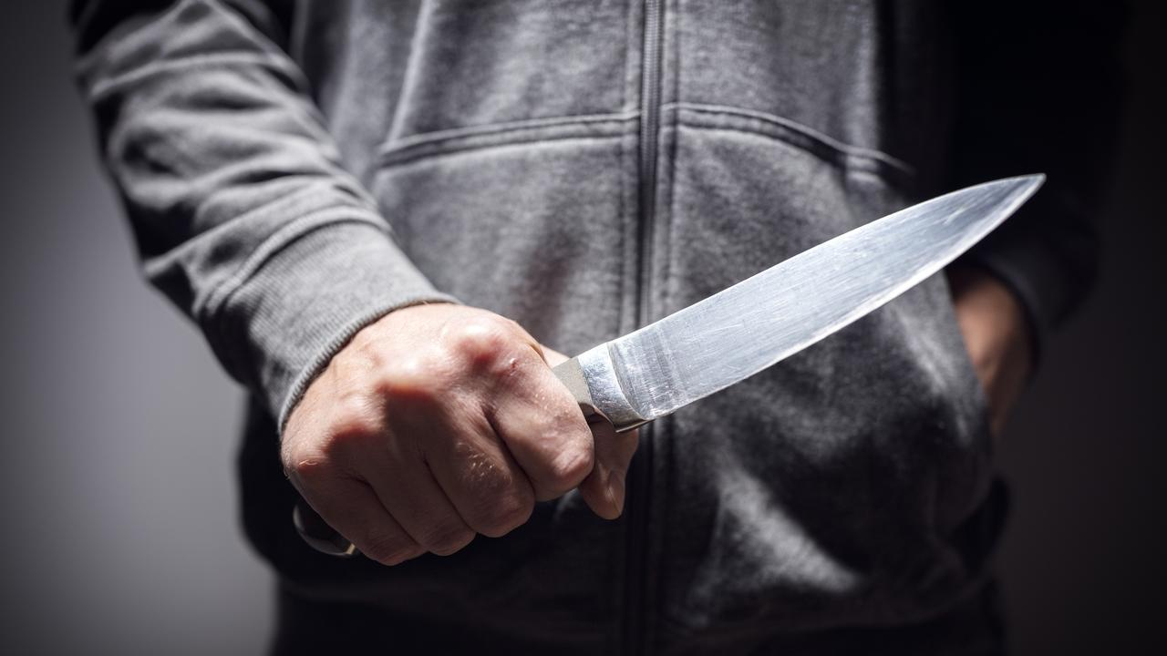 generic criminal with knife weapon threatening to stab