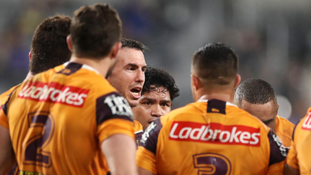 Darius Boyd reads the riot act to the Broncos players.