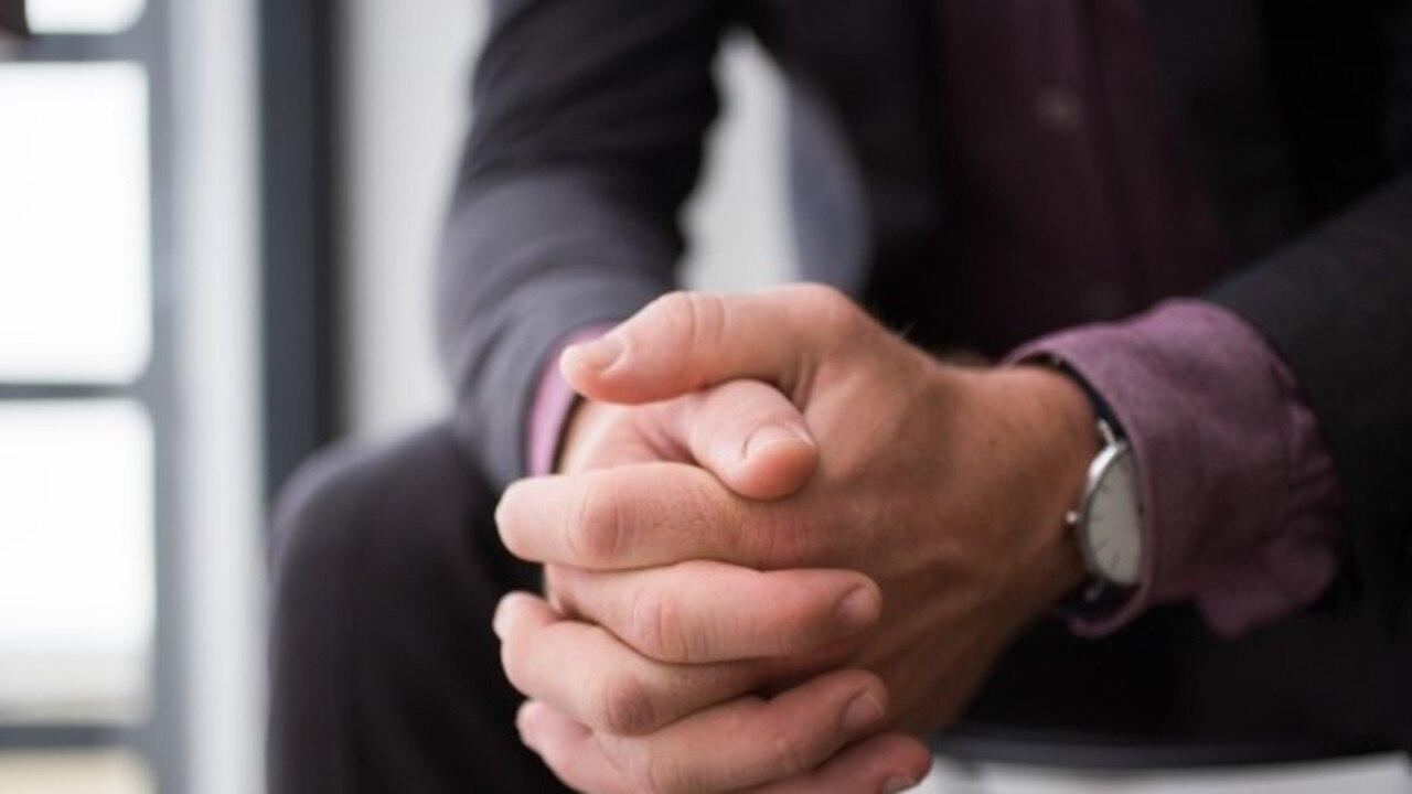 Church, praying, prayer, man resting hands on knees, generic image,