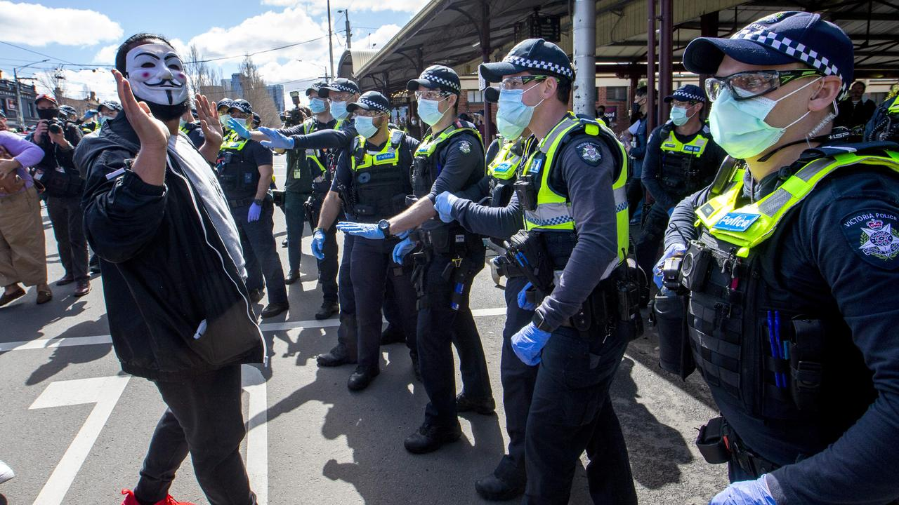 Police clash with protestors at a Melbourne Freedom Walk at Queen Victoria Market on Sunday. Picture: NCA NewsWire / David Geraghty