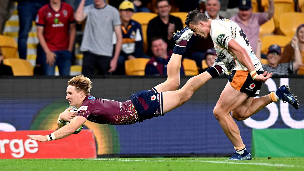 Tate McDermott of the Reds scores a try during the round 10 Super Rugby AU match against the Brumbies at Suncorp Stadium. Picture: Bradley Kanaris/Getty Images.