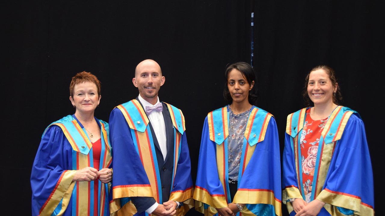 CQU PHD graduates Dr Cheryl Bookallil, Dr Adam Rose, Dr Addisalem Benyam and dr Jordon Irwin from a previous graduation.