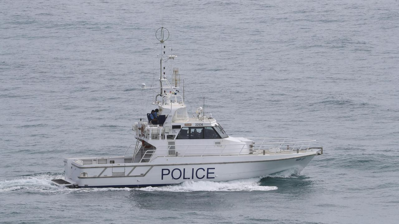 Authorities are carrying out an extensive air and sea search for a  woman missing on Fraser Island.