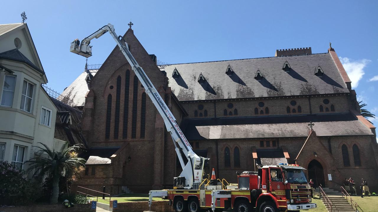 A Bronto skiylift from the Gold Coast is at the scene of the St Carthage's Cathedral fire so firefighters can assess damage to the roof.