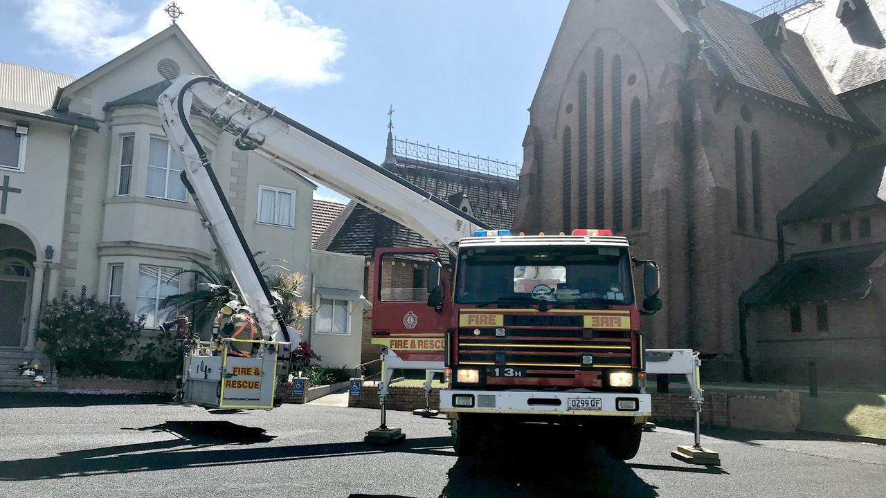 GOLD COAST HELPS OUT: A Bronto skiylift from the Gold Coast is at the St Carthage's Cathedral fire so firefighters can assess damage to the roof.