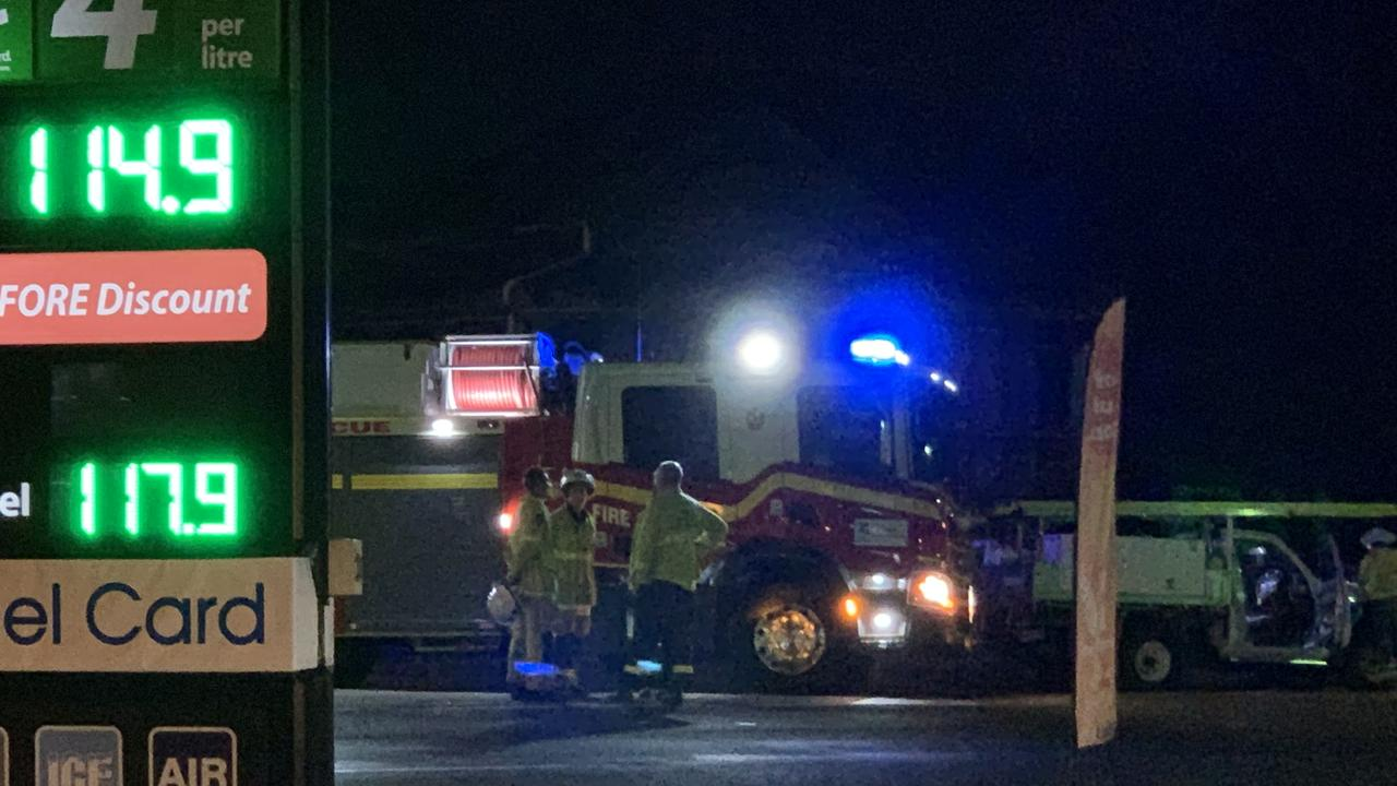 A car has crashed into a light pole outside a South Rockhampton service station.