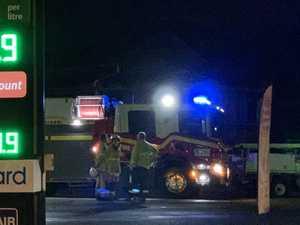 Woman hospitalised after car crashes outside servo
