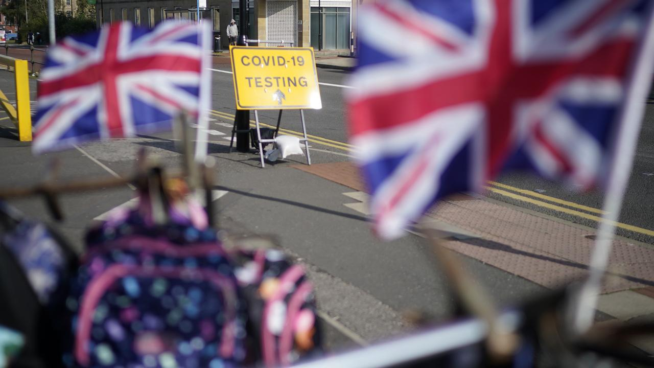 A sign outside Bolton Market in England directs people to the COVID-19 testing centre. Picture: Christopher Furlong/Getty Images