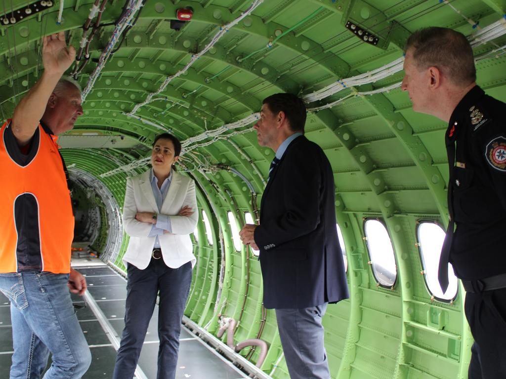 Premier Annastacia Palaszczuk, Treasurer Cameron Dick and QFES Commissioner Greg Leach are shown the inside of the aerial tanker.