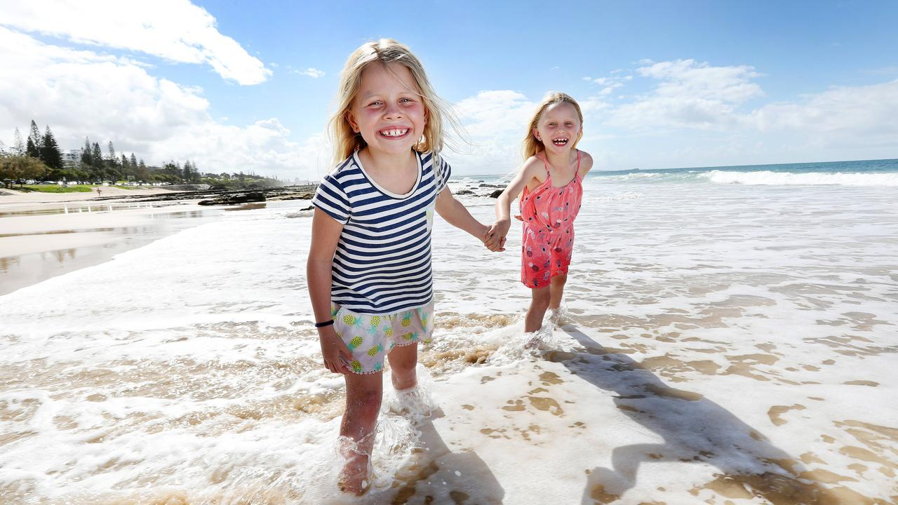 Gold Coast twins Macie and Asha Brindley enjoying school holidays at Mooloolaba Beach. Picture: Tara Croser
