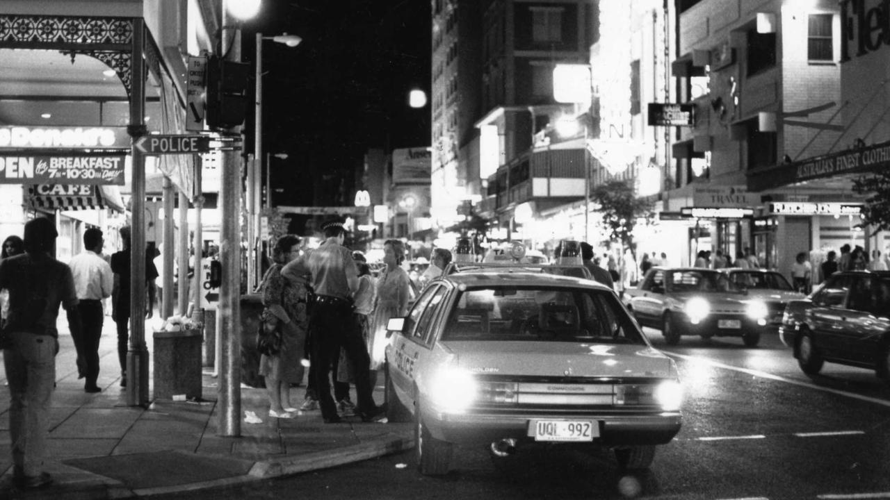 A police officer talking to youths, around 11.30pm in the early 1990s.
