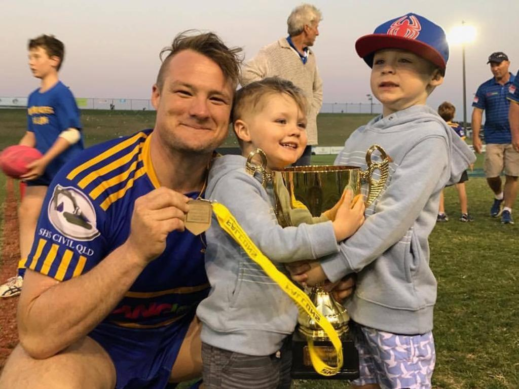 Noosa Pirates stalwart Liam Anlezark with his sons Kye and Braxton after the 2017 premiership win. He has named his 1-17 of greatest teammates.