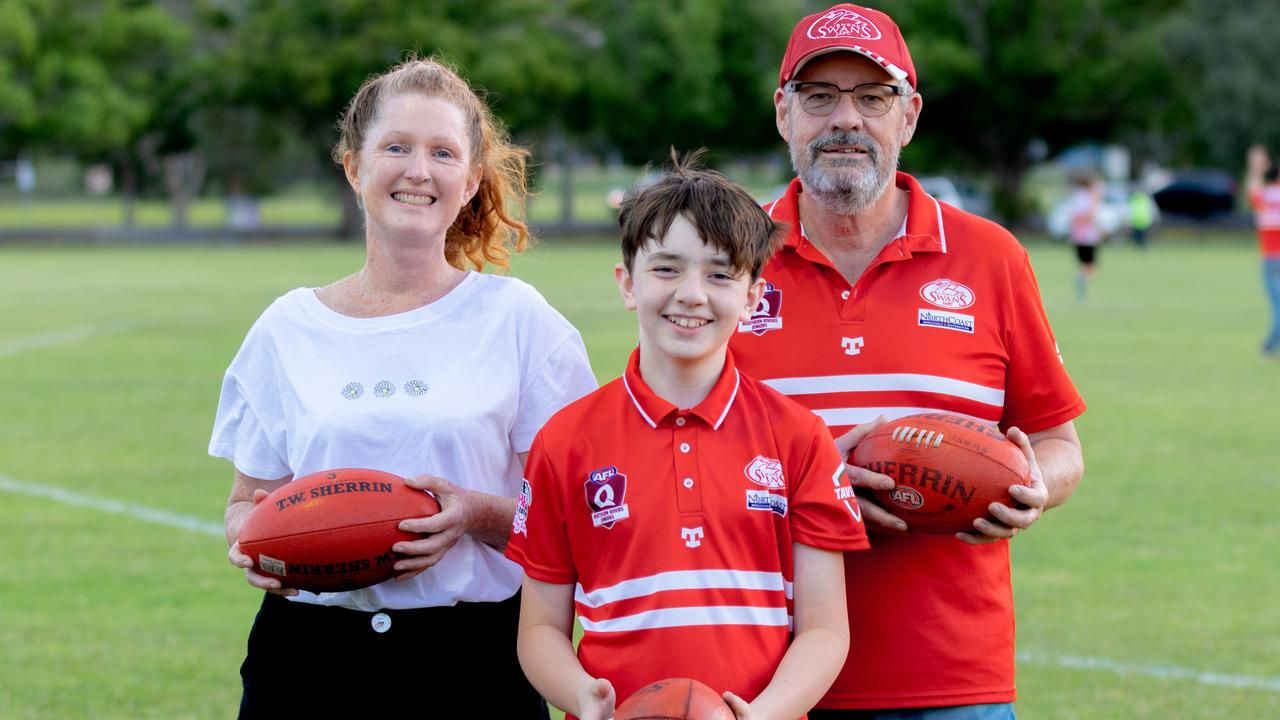 FABULOUS FOOTY: Human Nature program manger, Jen Parke, with talented Lismore Swans junior player Zack Connelly and Lismore Swans committee member David Bowker after the cub donated a huge of footballs to the outdoor mental health program. Daniel Cohen / dcsportsphotography