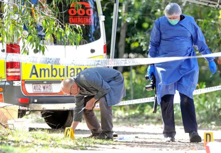 Police and emergency services at the crime scene in Ranora St, Russell Island. Picture, John Gass