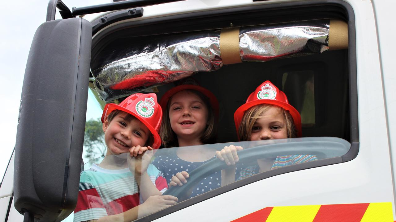 Jesse, Makenna and Elliett enjoy some time in the RFS Orara tanker during the Get Ready Weekend. They all said when they are old enough they would be joining up.