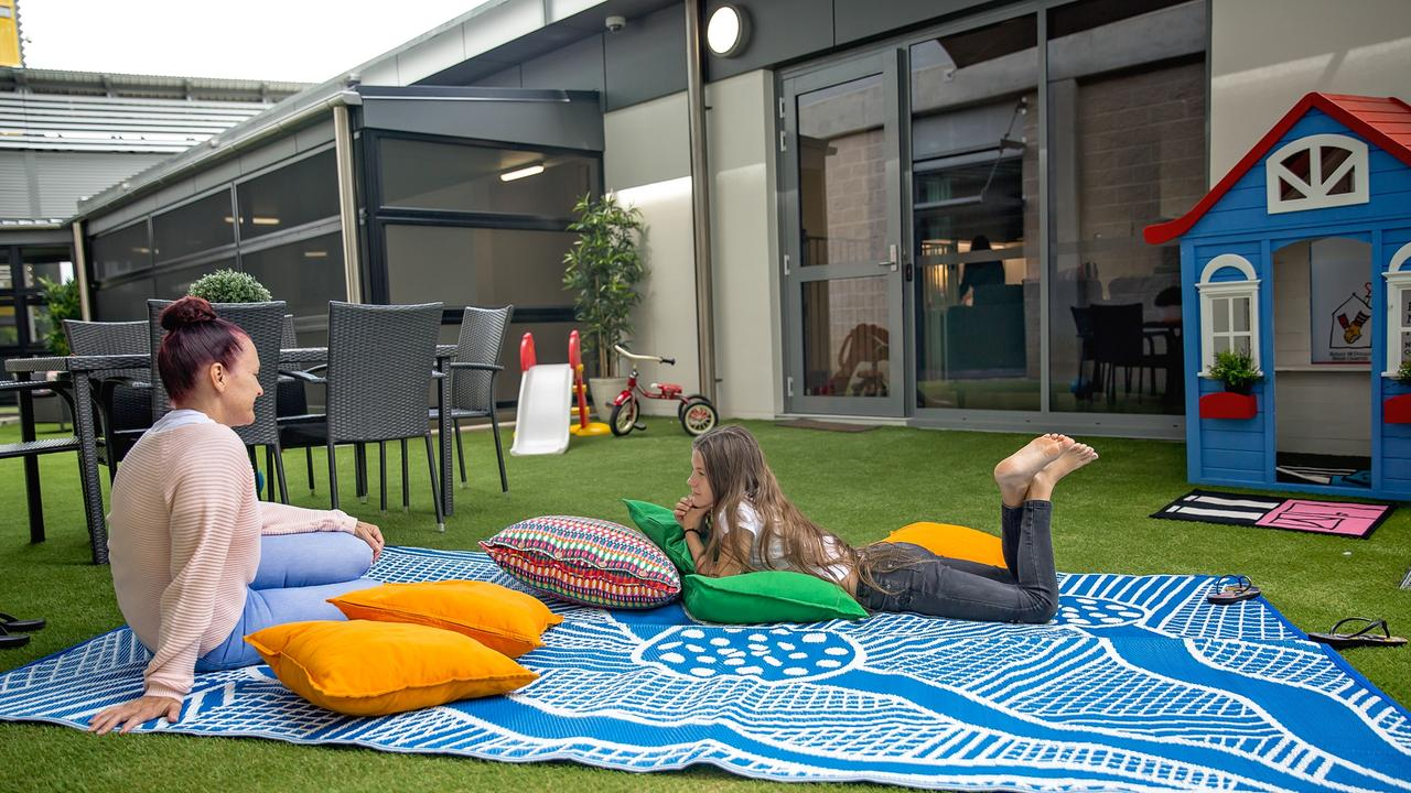 Leonie and Mackealie Twidale using the outdoor space at the Ronald McDonald Family Room in Townsville.