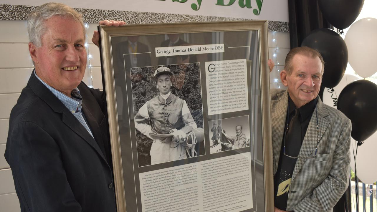 Mackay Regional Council Mayor Greg Williamson and horse breeder Paul Maguire with a tribute to racing legend George Moore at Mackay Turf Club on Saturday September 20. Picture: Zizi Averill
