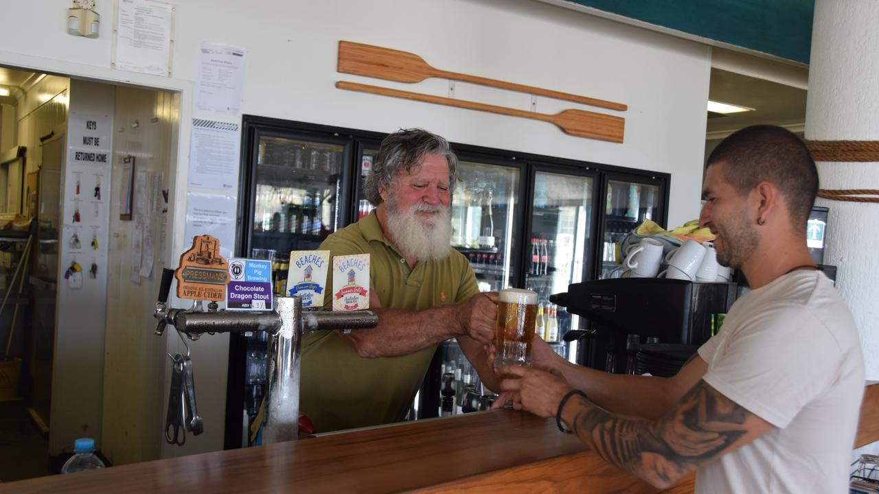 Beaches Bistro Rosslyn Bay owner Ross O'Reilly pours a beer for new staff member Jonathan Benitez.