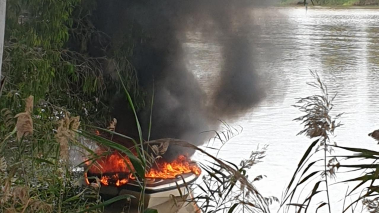 A boat went up in flames on the Fitzroy River near Rockhampton this morning. Photo supplied.