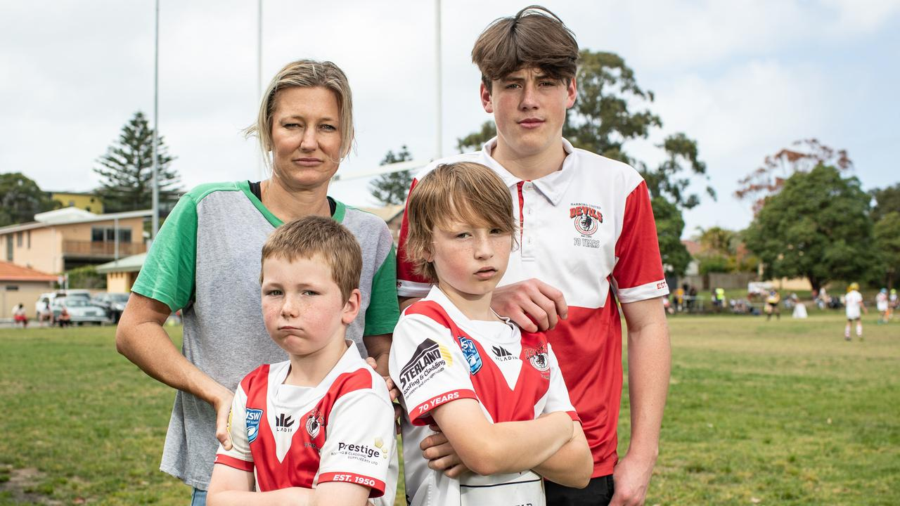 Harbord Devils Junior Rugby League players Max Crotty-King (17), Noah Smith (7) Astin Smith (9) and their Mum Amy Smith. Picture: Julian Andrews.