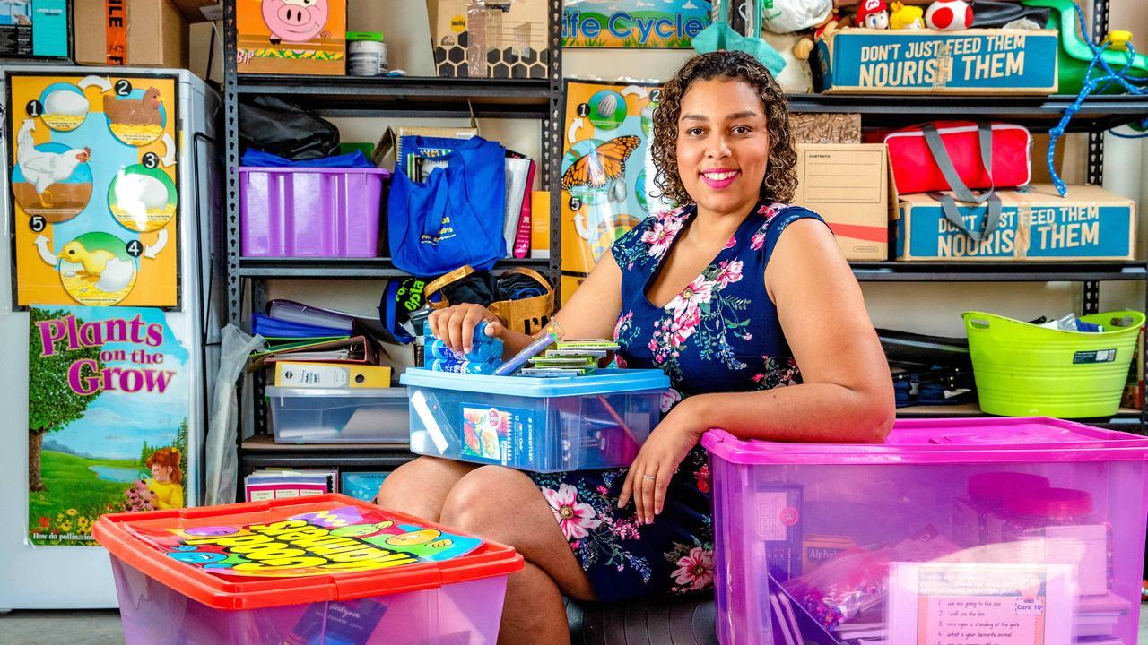 Primary schoolteacher Natalie Montague-Clarke at home with her spare school supplies. Picture: Richard Walker
