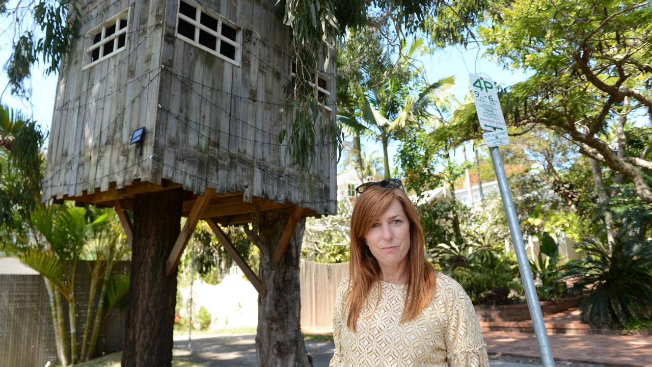 Byron Bay mother Mellanie Coppin with the treehouse outside her home. A lease for the use of the road reserve area will go back before Byron Shire Council soon.