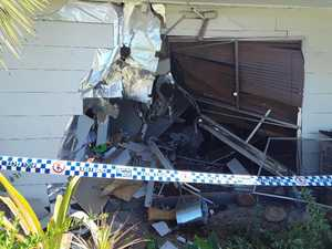 Young woman charged after car crashes through house