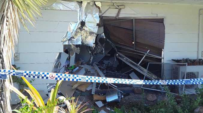 Driver, 24, charged after car crashes through house