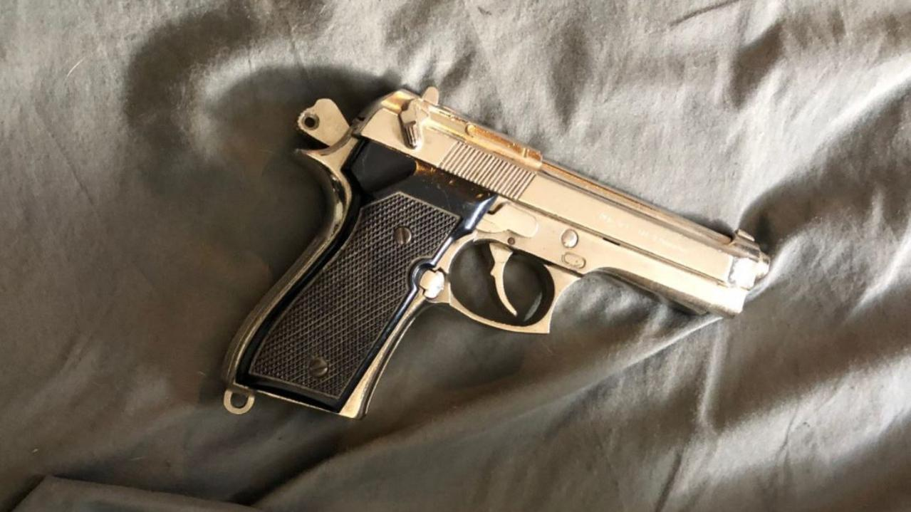 A handgun allegedly located by officers.
