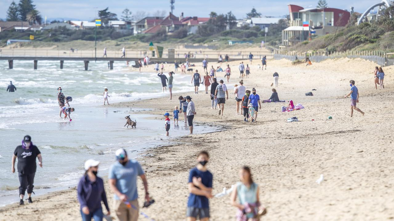 Beachgoers enjoying the weekend's warm weather at Frankston Beach. Picture: Tim Carrafa
